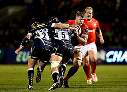 George Kruis of Saracens is tackled by Rob Webber and Andrei Ostrikov of Sale Sharks - Mandatory by-line: Robbie Stephenson/JMP - 18/12/2016 - RUGBY - AJ Bell Stadium - Sale, England - Sale Sharks v Saracens - European Champions Cup
