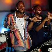 Miami Beach, FL / 2005 - Buffalo Bills running back Willis McGahee (left) sings along with DJ Irie in the disc jockey booth at the nightclub Crobar in Miami Beach. Photo by Mike Roy / For The Miami Herald