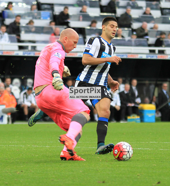 Newcastle United V Norwich City Premier League 18th October 2015; John Ruddy (Norwich, 1) clears under pressure from Aleksandar Mitrovic (Newcastle, 45)  during the Newcastle V Norwich match, played at St. James Park, Newcastle.