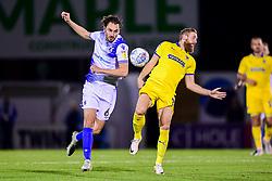 Edward Upson of Bristol Rovers contends for the aerial ball with Scott Wagstaff of AFC Wimbledon - Mandatory by-line: Ryan Hiscott/JMP - 23/10/2018 - FOOTBALL - Memorial Stadium - Bristol, England - Bristol Rovers v AFC Wimbledon - Sky Bet League One