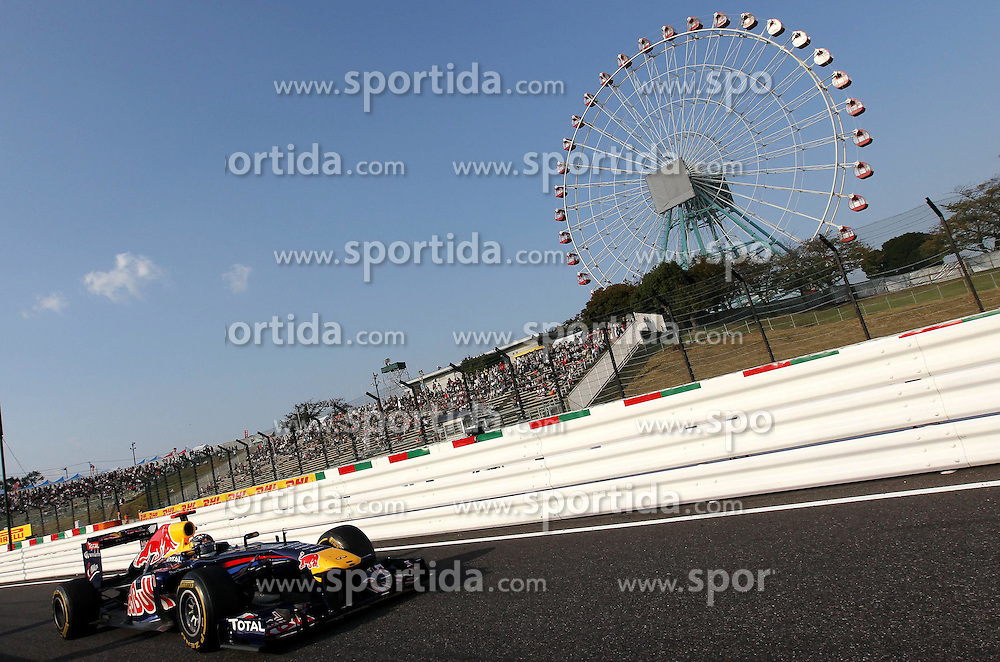 08.10.2011, Suzuka International Racing Course, Suzuka, JPN, F1, Grosser Preis von Japan, Suzuka, im Bild DHL Branding - Sebastian Vettel (GER), Red Bull Racing .for Austria & Germany Media usage only!// during the Formula One Championships 2011 Large price of Suzuka held at the Suzuka International Racing Course, 2011-10-08  EXPA Pictures © 2011, PhotoCredit: EXPA/ nph/  Dieter Mathis        ****** only for AUT, POL & SLO ******