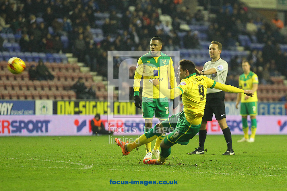 Kyle Lafferty of Norwich takes a free kick but slips over during the Sky Bet Championship match at the DW Stadium, Wigan<br /> Picture by Paul Chesterton/Focus Images Ltd +44 7904 640267<br /> 06/12/2014