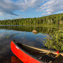 A canoe on the shore of Bald Mountain Pond. Bald Mountain Township, Maine.