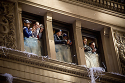 Series of images of people in elevated positions watching parade activity..---.Tue Feb 07, 2012: New York City Parade for Super Bowl champion NY Giants. Images of those that gathered along the parade route..Credit: Rob Bennett for The Wall Street Journal  Slug: PARADE