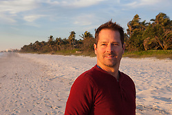 portrait of a handsome middle aged man on the beach in Naples, Florida at sunset