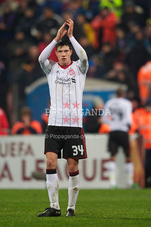 BUCHAREST, ROMANIA - Thursday, December 2, 2010: Liverpool's Martin Kelly applauds the travelling supporters after his side's 1-1 draw with FC Steaua Bucuresti during the UEFA Europa League Group K match at the Stadionul Steaua. (Pic by: David Rawcliffe/Propaganda)