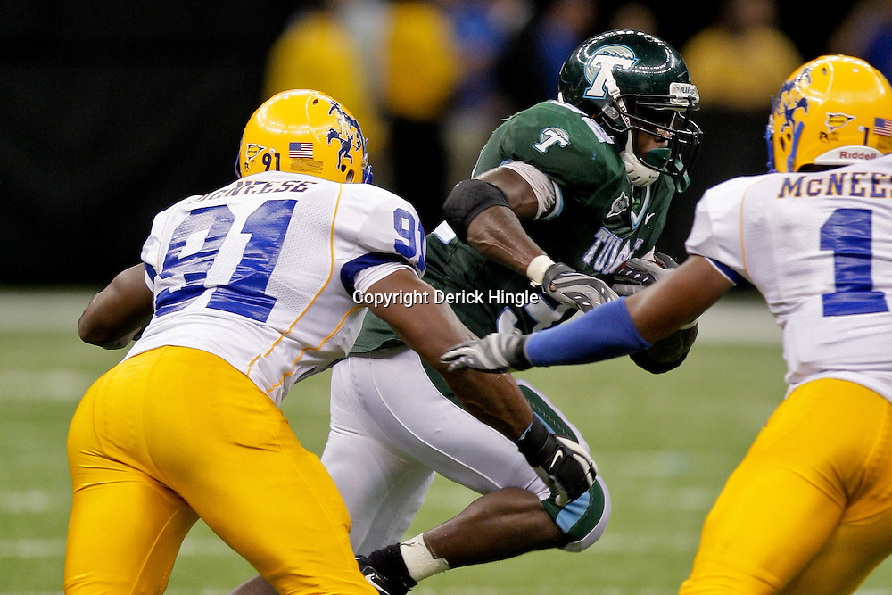 Sep 26, 2009; New Orleans, LA, USA;  McNesse State Cowboys defensive end Josh Ellison (91) and safety Devin Holland (1) pursue Tulane Green Wave running back Andre Anderson (32) at the Louisiana Superdome. Tulane defeated McNeese State 42-32. Mandatory Credit: Derick E. Hingle-US PRESSWIRE