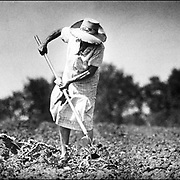 A farmers wife prepares for planting outside Lawrence , Kansas.