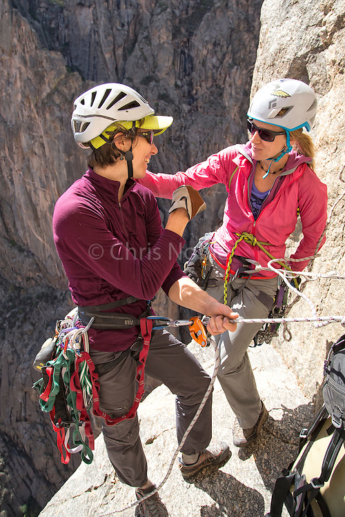 "Madaleine Sorkin and Kate Rutherford supporting one another while climbing the ""Free Nose,"" 12c, in the Black Canyon of the Gunnison."