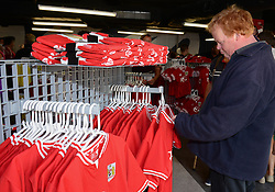 A Bristol City fan picks up a Bristol City replica shirt at the Club Shop - Mandatory byline: Dougie Allward/JMP - 07966386802 - 15/08/2015 - FOOTBALL - Ashton Gate -Bristol,England - Bristol City v Brentford - Sky Bet Championship