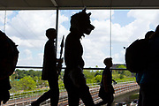 UNITED KINGDOM, London: 25 May 2019 <br /> The silhouette of a cosplay fan dressed as a werewolf is cast across a window as people make their way to MCM London Comic Con. Thousands of cosplay enthusiasts will come to the ExCeL Centre this weekend to enjoy the convention.