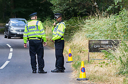 Police stand guard at the end of Pease Hill, Bucklebury, Berkshire, where Prince William and Kate have gone with their baby son, <br /> Berkshire, United Kingdom<br /> Wednesday, 24 July 2013<br /> Picture by i-Images
