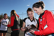 Sofia Fenwick of the Tactix signs an autograph for Eve Wellby, 13 of the Southbridge Netball Club during the ANZ Championship Roadshow, Win a Warmup, held at the Selwyn Netball Centre, Lincoln. 17 May 2014 Photo: Joseph Johnson/www.photosport.co.nz