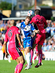 Bristol Rovers' Matty Taylor is challenged by Dover Athletic's Tom Bonner - Photo mandatory by-line: Neil Brookman - Mobile: 07966 386802 - 04/10/2014 - SPORT - Football - Bristol - Memorial Stadium - Bristol Rovers v Dover - Vanarama Football Conference