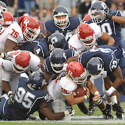 Oct 31, 2009; East Hartford, CT, USA; The pile falls on Rutgers running back Joe Martinek (38) during second half Big East NCAA football action in Rutgers' 28-24 victory over Connecticut at Rentschler Field.