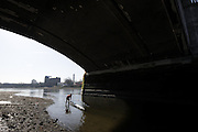 Chiswick. London. Tideway Scullers boathouse. Sculler, boating for training, looking from the foreshore, passing under Chiswick Bridge. 2011 Women's Head of the River Race, Mortlake to Putney, over the  Championship Course. Saturday  19/03/2011 [Mandatory Credit, Peter Spurrier/Intersport-images]