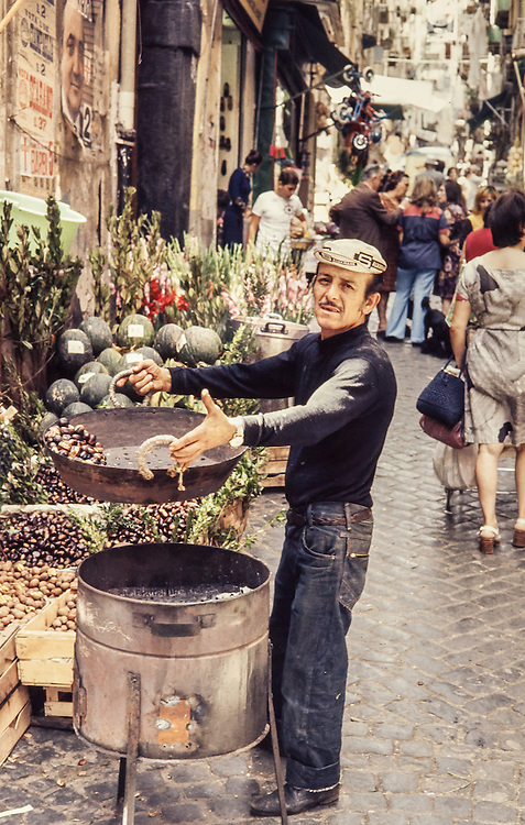 chestnut vendor in street alley in Naples Italy