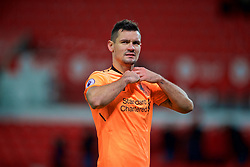STOKE-ON-TRENT, ENGLAND - Wednesday, November 29, 2017: Liverpool's Dejan Lovren takes his shirt off to give to the travelling supporters after the FA Premier League match between Stoke City and Liverpool at the  Bet365 Stadium. (Pic by David Rawcliffe/Propaganda)