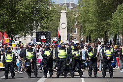 """© Licensed to London News Pictures . 06/05/2018. London, UK. Police separate anti fascists on Whitehall . Supporters of alt-right and anti-Islam groups, including Generation Identity and the Democratic Football Lads Alliance, demonstrate at Whitehall in Westminster, opposed by anti-fascists. Speakers billed in the """"Day for Freedom"""" include former EDL leader Tommy Robinson, Milo Yiannopoulos, youtuber Count Dankula (Markus Meechan), For Britain leader Anne Marie Waters, UKIP leader Gerard Batten, Breitbart's Raheem Kassam and Lauren Southern. The event was originally planned as a march to Twitter's HQ in protest at their banning of Robinson and the Home Office's ban on Martin Sellner and Brittany Pettibone entering the UK, in what protesters describe as limits being imposed on free speech. Photo credit: Joel Goodman/LNP"""