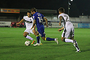 AFC Wimbledon midfielder Tom Beere (16) and Plymouth Argyle striker Craig Tanner (27) and Plymouth Argyle defender & captain Gary Miller (2) AFC Wimbledon and Plymouth Argyle at the Cherry Red Records Stadium, Kingston, England on 4 October 2016. Photo by Stuart Butcher.