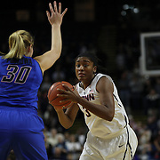 Morgan Tuck, UConn, drives to the basket defended by Megan Podkowa, DePaul, during the UConn Vs DePaul, NCAA Women's College basketball game at Webster Bank Arena, Bridgeport, Connecticut, USA. 19th December 2014