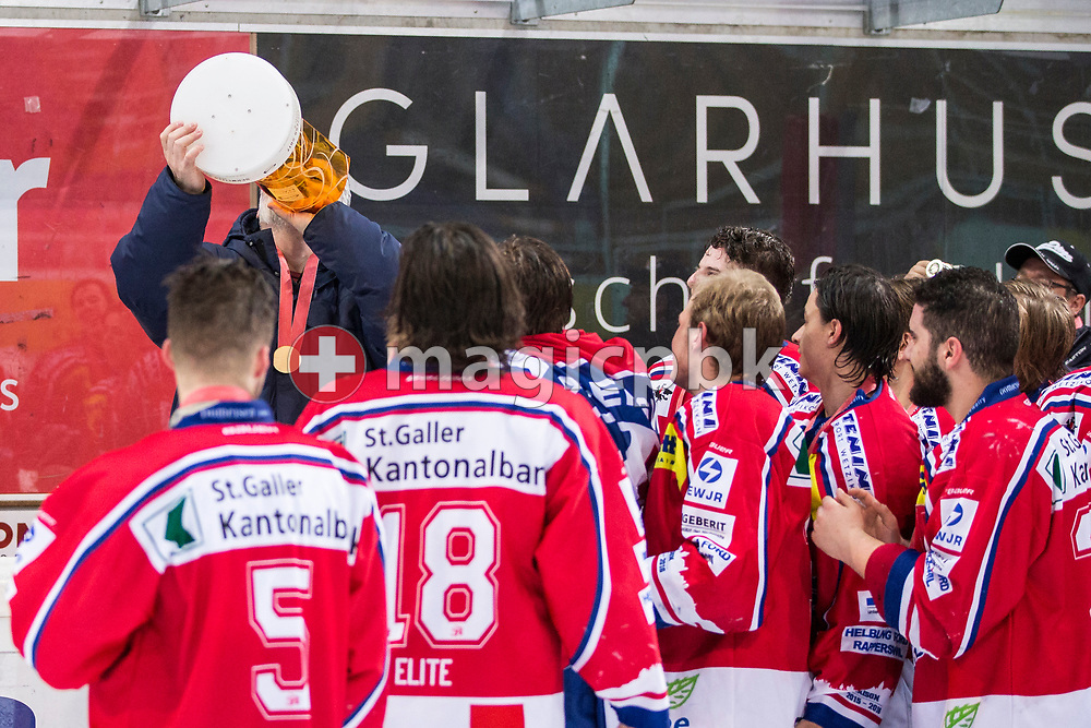 Rapperswil-Jona Lakers head coach Konstantin Kurashev celebrates with the Swiss champion trophy after winning the fifth Elite B Playoff Final ice hockey game between Rapperswil-Jona Lakers and ZSC Lions held at the SGKB Arena in Rapperswil, Switzerland, Sunday, Mar. 19, 2017. (Photo by Patrick B. Kraemer / MAGICPBK)