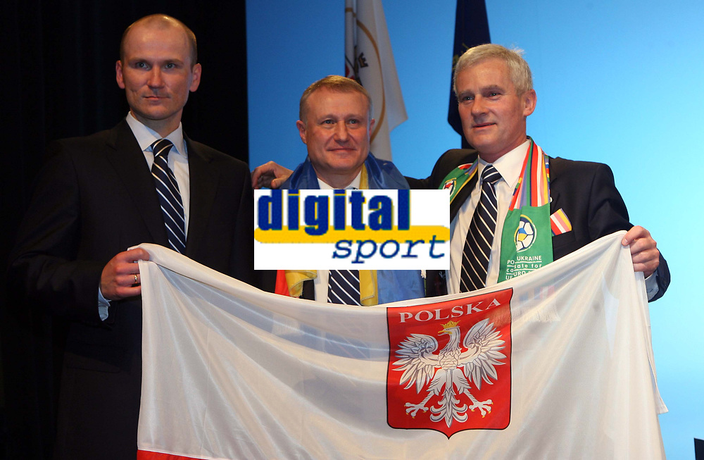 Photo: Rich Eaton.<br /> <br /> UEFA European Championships 2012 Press Conference. 18/04/2007. Michal Listkiewicz right, President of Polish FA and Grygoriy Surkis centre, President of Ukraine FA pictured with the Polish Minister of Sport (left) after they are announced as host nations