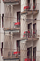 Ticino, Southern Switzerland. Reflections on a Locarno building. Photograph forms an interesting pattern from a Locarno balcony.