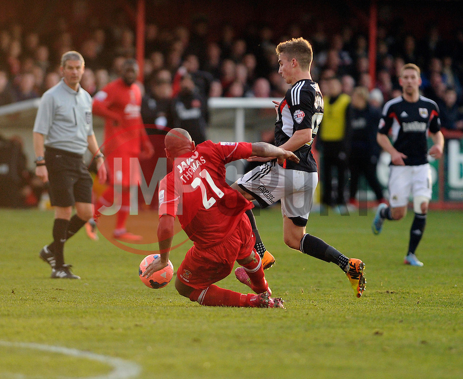 Bristol City's Joe Bryan is challenged by Tamworth's Wayne Thomas - Photo mandatory by-line: Dougie Allward/JMP - Tel: Mobile: 07966 386802 08/12/2013 - SPORT - Football - Tamworth - The Lamb Ground - Tamworth v Bristol City - FA Cup - Second Round