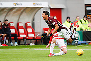 Hearts FC Forward Osman Sow takes a sore tackle during the Ladbrokes Scottish Premiership match between Hamilton Academical FC and Heart of Midlothian at New Douglas Park, Hamilton, Scotland on 24 January 2016. Photo by Craig McAllister.