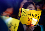 "Seoul, South Korea. 3rd May 2014. People participate in a protest against what they insist, lax response of President Park Geun-hye's government after the Sewol ferry was sunken in waters off the southwestern island of Jindo on April 16, 2014, at the Cheonggye plaza, Seoul, South Korea, on Saturday May 3, 2014. Protesters demanded Park resign. Signs read,""Save the children""."