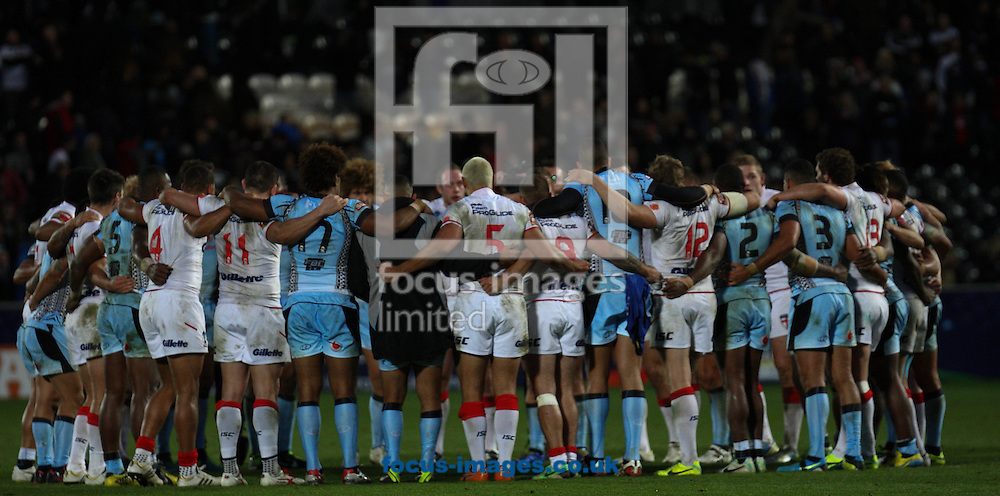 Picture by Stephen Gaunt/Focus Images Ltd +447904 833202<br /> 09/11/2013<br /> England and Fiji hold a pray after the game during the Rugby League World Cup 2013 match at the KC Stadium, Kingston upon Hull.