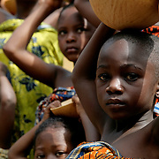 Young girls from the Krobo tribal group hold calabashes used to carry rain water on their heads as they undergo puberty rites - locally called dipo - in Somanya, Eastern Region, Ghana.