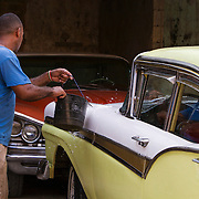 Cubans manage their daily life wether waiting for overcrowded busses or doubling up on old classic cars and motorcycles. <br /> Photography by Jose More