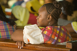 Woman in church during service on Garifuna Settlement Day, annual festival held in late November, Dangriga, Stann Creek District, Belize, Central America