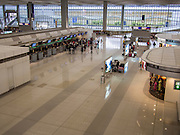 14 AUGUST 2013 - HONG KONG: An empty terminal in Hong Kong International Airport. Dozens of flights were delayed at one of the busiest airports in Asia and Hong Kong raised their alert to level 8, the highest, and closed schools and many businesses because of Severe Typhoon Utor. The storm passed within 260 kilometers of Hong Kong before making landfall in mainland China. Severe Typhoon Utor (known in the Philippines as Typhoon Labuyo) is an active tropical cyclone located over the South China Sea. The eleventh named storm and second typhoon of the 2013 typhoon season, Utor formed from a tropical depression on August 8. The depression was upgraded to Tropical Storm Utor the following day, and to typhoon intensity just a few hours afterwards. The Philippines, which bore the brunt of the storm, reported 1 dead in a mudslide and 23 fishermen missing at sea.   PHOTO BY JACK KURTZ
