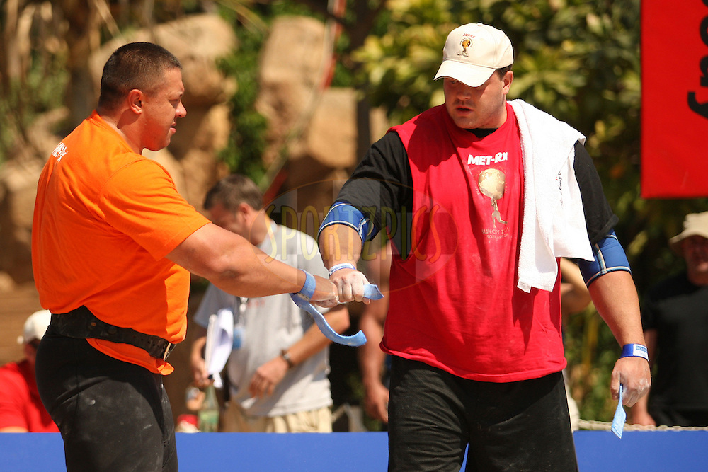 Mikhail Koklyaev (Russia) on the left and Dave Ostlund (USA) wish each other good luck before the deadlift (for time) during one of the qualifying rounds of the World's Strongest Man competition held in Sun City, South Africa.