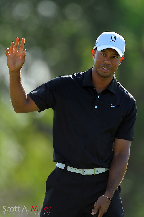 Tiger Woods waves to the gallery after a birdie on the 15th hole during the first round of the Arnold Palmer Invitational at the Bay Hill Club and Lodge on March 22, 2012 in Orlando, Fla. ..©2012 Scott A. Miller.
