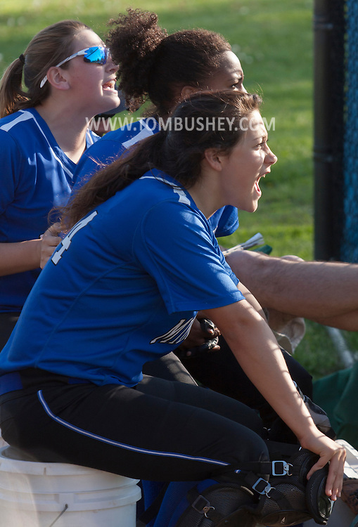 Middletown, New York - Middletown players cheer for their team during a varsity girls' softball game on May 19, 2014.