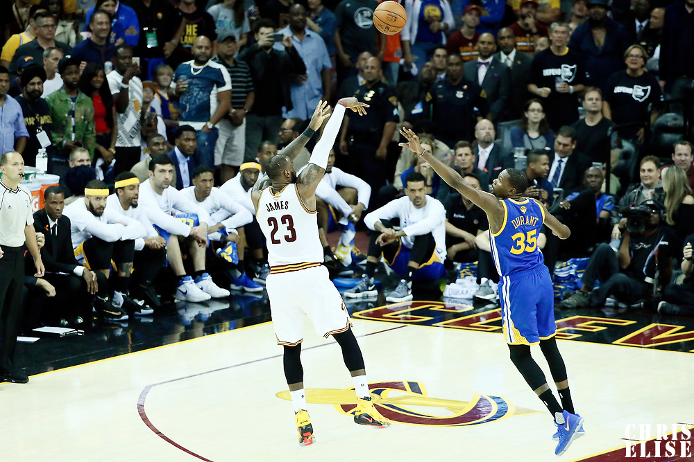 09 June 2017: Golden State Warriors forward Draymond Green (23) takes a jump shot over Golden State Warriors forward Kevin Durant (35) during the Cleveland Cavaliers 137-11 victory over the Golden State Warriors, in game 4 of the 2017 NBA Finals, at  the Quicken Loans Arena, Cleveland, Ohio, USA.