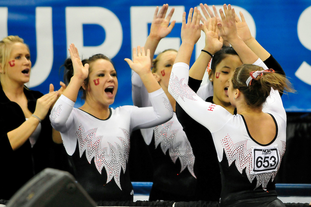University of Utah junior Stephanie McAllister, left, and sophomore Fumina Kobayashi celebrate with freshman Lia Del Priore after her floor exercise routine at the 2011 Women's NCAA Gymnastics Championship Team Finals on April 16, in Cleveland, OH. (photo/Jason Miller)