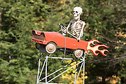 Skeleton driving a car ornament outside a house in Windsor County, Vermont.