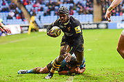 Wasps wing Christian Wade (14) Tackled during the Aviva Premiership match between Wasps and London Irish at the Ricoh Arena, Coventry, England on 4 March 2018. Picture by Dennis Goodwin.