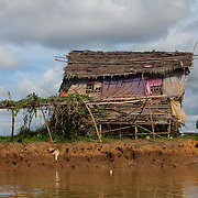 A house on the banks of the Mekong River, Cambodia.<br />