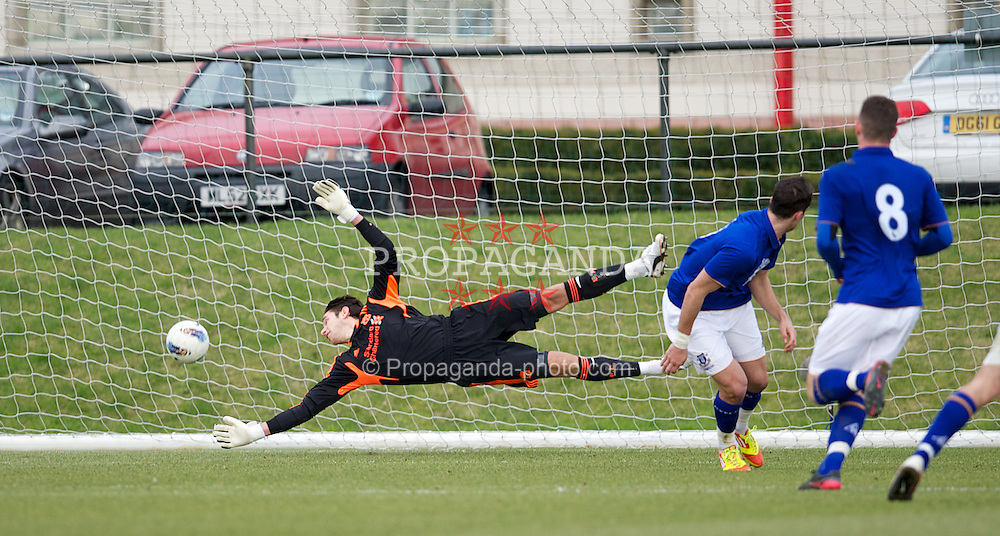 KIRKBY, ENGLAND - Tuesday, February 21, 2012: Liverpool's goalkeeper Brad Jones is beaten by Everton's Apostolos Vellios for the opening goal during the FA Premier Reserve League match at the Kirkby Academy. (Pic by David Rawcliffe/Propaganda)