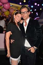 DAME NATALIE MASSENET and ERIC TORSTENSSON at The Naked Heart Foundation's Fabulous Fund Fair hosted by Natalia Vodianova and Karlie Kloss at Old Billingsgate Market, 1 Old Billingsgate Walk, London on 20th February 2016.