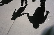 shadow of father and son walking