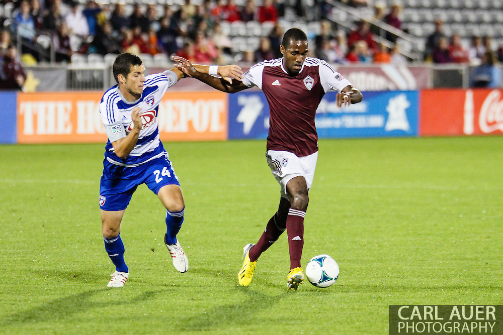 September 14th, 2013 -  Colorado Rapids midfielder Atiba Harris (16) tries to make a move past FC Dallas defender Matt Hedges (24) in the first half of the MLS Soccer game between FC Dallas and the Colorado Rapids at Dick's Sporting Goods Park in Commerce City, CO