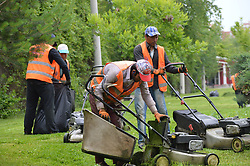 June 21, 2017 - Ankara, Turkey - Municipality workers mow grass at the park in summer in Ankara, Turkey on June 21, 2017. (Credit Image: © Altan Gocher/NurPhoto via ZUMA Press)
