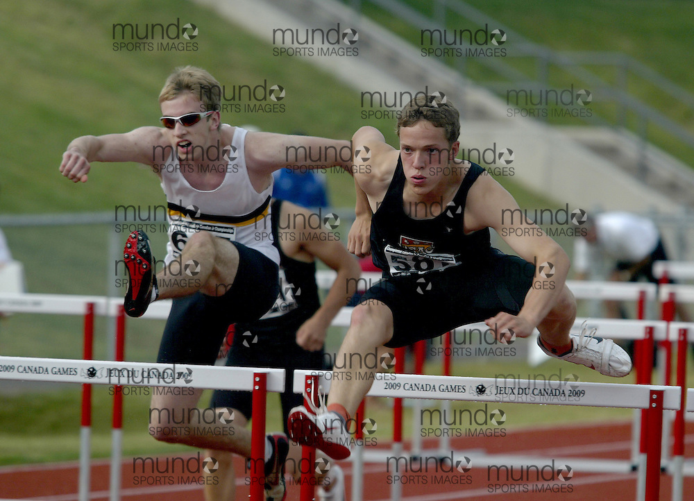 (Charlottetown, Prince Edward Island -- 20090719) Tim Nedow of Ottawa Lions T.F.C. competes in the  (445) and Trent Johnston of U OF C Athletics Club competes in the  (582)\decathlon 110m hurdles at the 2009 Canadian Junior Track & Field Championships at UPEI Alumni Canada Games Place on the campus of the University of Prince Edward Island, July 17-19, 2009.  Copyright Sean Burges / Mundo Sport Images , 2009...Mundo Sport Images has been contracted by Athletics Canada to provide images to the media.
